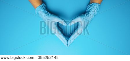Doctor's Hands In Medical Gloves In Shape Of Heart On Blue Background, Banner Size, With Copyspace F