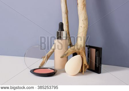Set Of Makeup Professional Products On Blue Background. Composition With Foundation, Eyeshadows, Blu