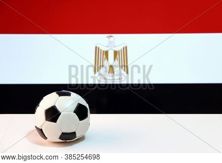 Small Football On The White Floor And Egyptian Nation Flag Background. The Concept Of Sport, Egypt I