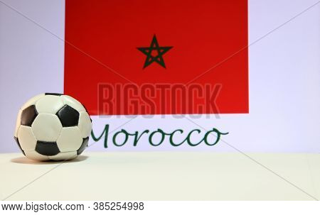 Small Football On The White Floor And Moroccan Nation Flag With The Text Of Morocco Background. The