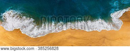 Panorama Of A Clean Beach. Aerial Photography Of A Clean Sandy Beach. Beautiful Beach With Yellow Sa