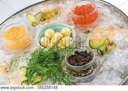 Assorted Caviar In Ice. Chum Salmon Caviar, Red Caviar, Pike Caviar And Butter