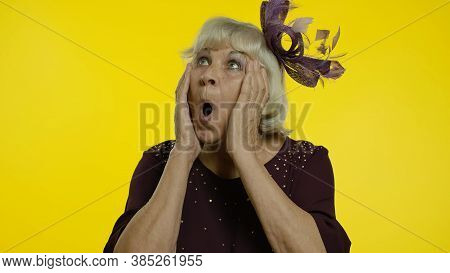 Oh My God Wow. Shocked Senior Old Woman Raising Hands In Surprise, Amazed By Sudden Victory, Opening