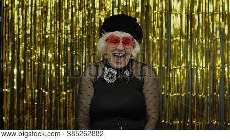 Happy Joyful Senior Old Woman Laughing Out Loud After Hearing Ridiculous Anecdote, Funny Joke, Feeli