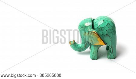 Figurine Of A Green Wooden Elephant With Gilding Isolated On White Background. Decorative Figurine O