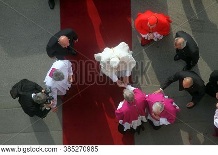 ZAGREB, CROATIA - JULY 13, 2011: Canons of Zagreb greet Pope Benedict at the entrance to the Zagreb Cathedral