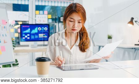 Successful Executive Asia Young Businesswoman Smart Casual Wear Drawing, Writing And Using Pen With