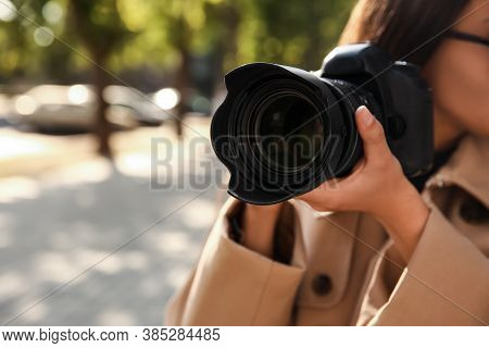 Private Detective With Camera Spying Outdoors, Closeup