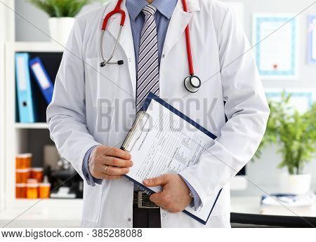 Stethoscope Lying On Male Doctor Chest In Office. Medic Store Physical And Patient Disease Preventio