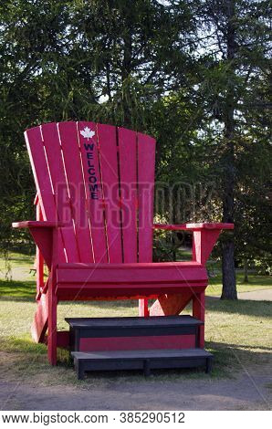 Large Red Adirondack Chair In Park¬ With Welcome On It
