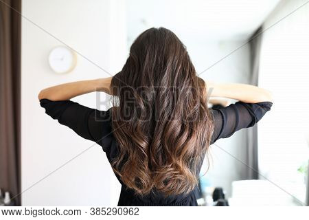Close-up Of Woman After Visiting Hairdresser. Long Curls Of Brunette Female Person. Hairdo For Holid