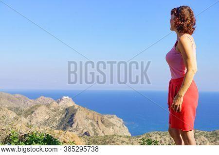 Tourist Woman Enjoy Coast View From Viewpoint Granatilla Carboneras In Cabo De Gata Natural Park, Pr