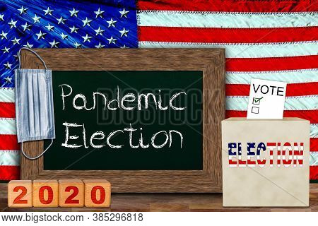 Us Pandemic Elections Concept With American Flag Hung Behind Wooden Frame Chalkboard For Copy Space,