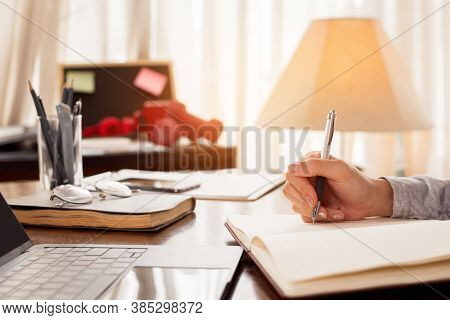 Close Up Woman Hand Working At Home. Hand Of Freelancer Writing Note For Work. Work At Home Concept.