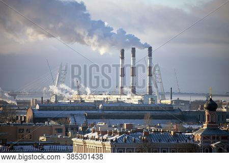 Smoke From The Pipes Of A Thermal Power Plant In The Frosty Air Over St. Petersburg. Air Pollution O