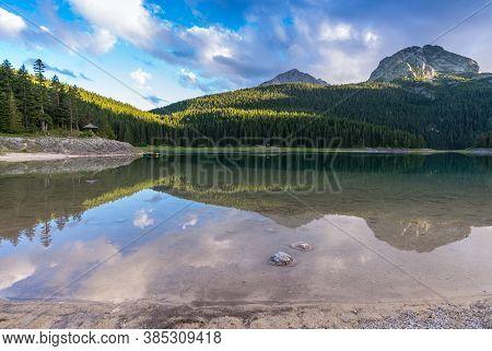 Beautiful Landscape Black Lake With Reflection. Zabliak, Durmitor,  Montenegro, Europe.