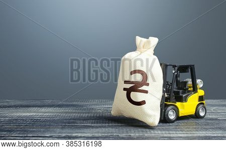 Forklift Transports A Ukrainian Hryvnia Money Bag. Investing In Economy. Economic Support, Lending.