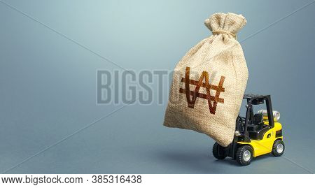 Forklift Carrying A South Korean Won Money Bag. Strongest Financial Assistance, Business Support. St
