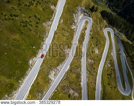 Aerial Top View On Scenic Curvy Mountain Pass Road To The Timmelsjoch At The Border Of Italy And Aus