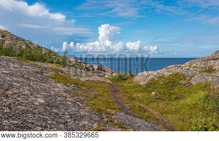 View Of Rocks Of The Archipelago Of Kuzova,sea, Blue Sky, Clouds. Kuzova Archipelago Located In The