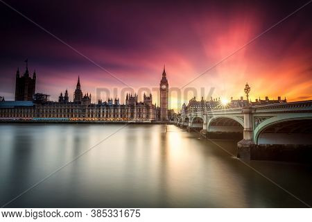 London Westminster And Big Ben Reflected On The Thames At Sunset