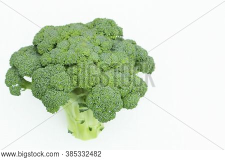 Fresh Green Broccoli On A Light Background. Health, Green, Fresh, Vegetarian.
