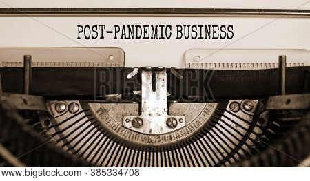 Text 'post-pandemic Business' Typed On Retro Typewriter. Business And Post-pandemic Covid-19 Concept