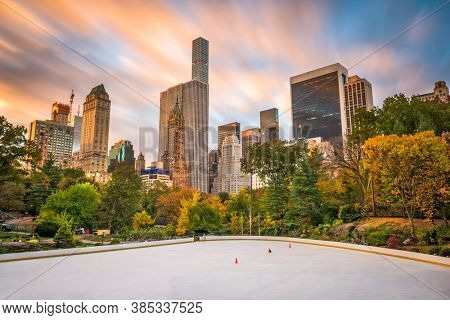 New York City skyline from Central Park in autumn.