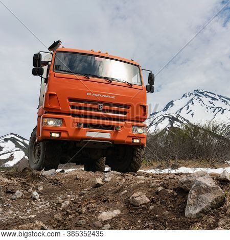Russian Off-road Expedition Passenger Truck Kamaz On Mountain Road On Background Of Volcano On Sunny