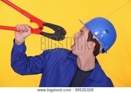 Man holding bolt cutters