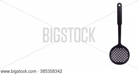 Black Plastic Ladle, Kitchen Utensil. Isolated On White Background, Copy Space Template, Banner.