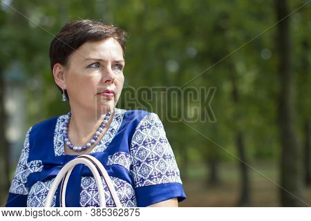 Ordinary Middle-aged Woman In The Park.the Woman Is Fifty Years Old.