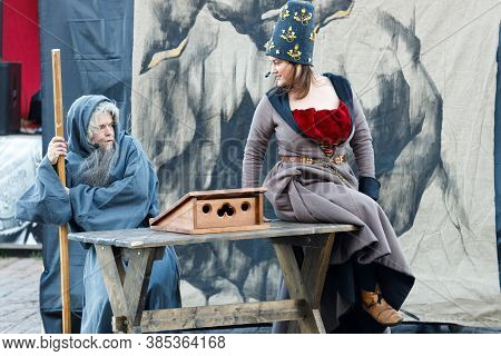 Russia. Vyborg. 08.22.2020 Theater Actor Dressed As A Monk Tempted By Demons At The Festival Of The
