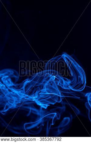 Conceptual Image Of Blue Color Smoke Isolated On Dark Black Background, Halloween Design Element Con