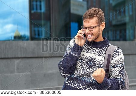 Emotional Business Man Freelancer Talking On The Phone. Successful Conversation With A Partner Or Cl