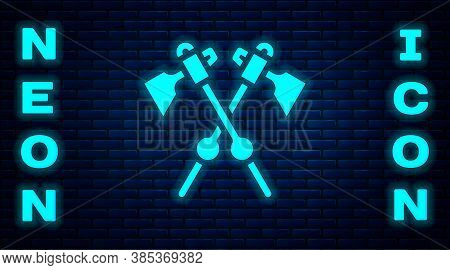 Glowing Neon Crossed Medieval Axes Icon Isolated On Brick Wall Background. Battle Axe, Executioner A