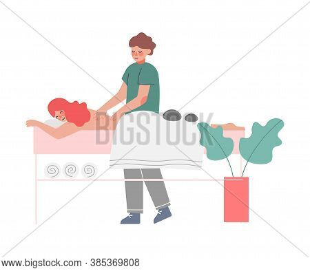 Therapist Doing Massage To Young Woman Lying Down On Table, Girl Relaxing, Reducing And Managing Str