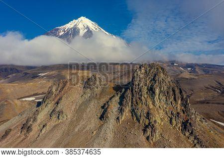 Verblyud (Camel) extrusion rock and the Koryaksky volcano on Kamchatka peninsula, Russia