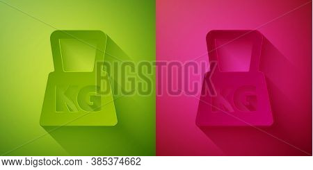 Paper Cut Weight Icon Isolated On Green And Pink Background. Kilogram Weight Block For Weight Liftin