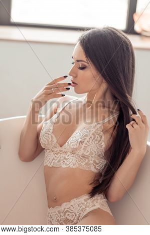 Young Sexy Woman In White Lace Lingerie Relaxing In A Bath