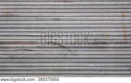Background Of Galvanized Corrugated Tin Iron With Traces Of Rust And Horizontal Orientation