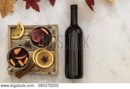 Hot Holiday Drink Mulled Wine With Oranges, Gloves, Anise Stars, And Cinnamon. Wooden Tray, Bottle O