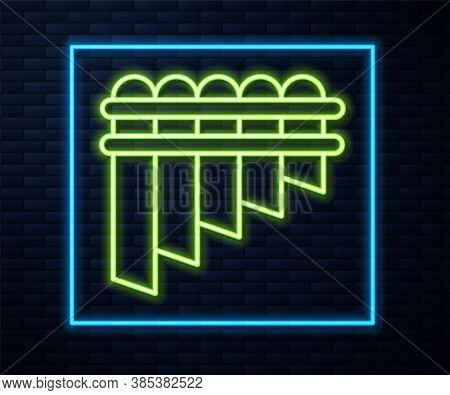 Glowing Neon Line Pan Flute Icon Isolated On Brick Wall Background. Traditional Peruvian Musical Ins