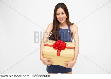 Happy Asian Woman Smile With Gold Gift Box Isolated On White Background. Teenage Girls In Love, Rece
