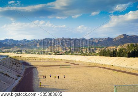 Andalusia, Spain - April 24, 2014: A Football Field On The Mountains On The Background. A Quiet And