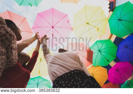 Dreaming About First Flight. Girls Pretending Fly,touch Sky. Women With Multi Colored Umbrellas. Dre