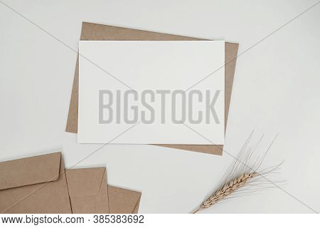 Blank White Paper On Brown Paper Envelope With Barley Dry Flower. Mock-up Of Horizontal Blank Greeti
