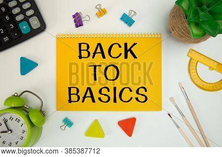 Blank Notepad With Text Back To Basics On An Office Desk With Office Accessories.