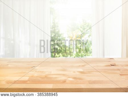 Empty Of Wood Table Top On Blur Of Curtain With Window View Green From Garden Background.for Montage