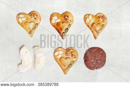 Christmas decoration on light background. Homemade gingerbread cookies on white background, lots of heart shapes.